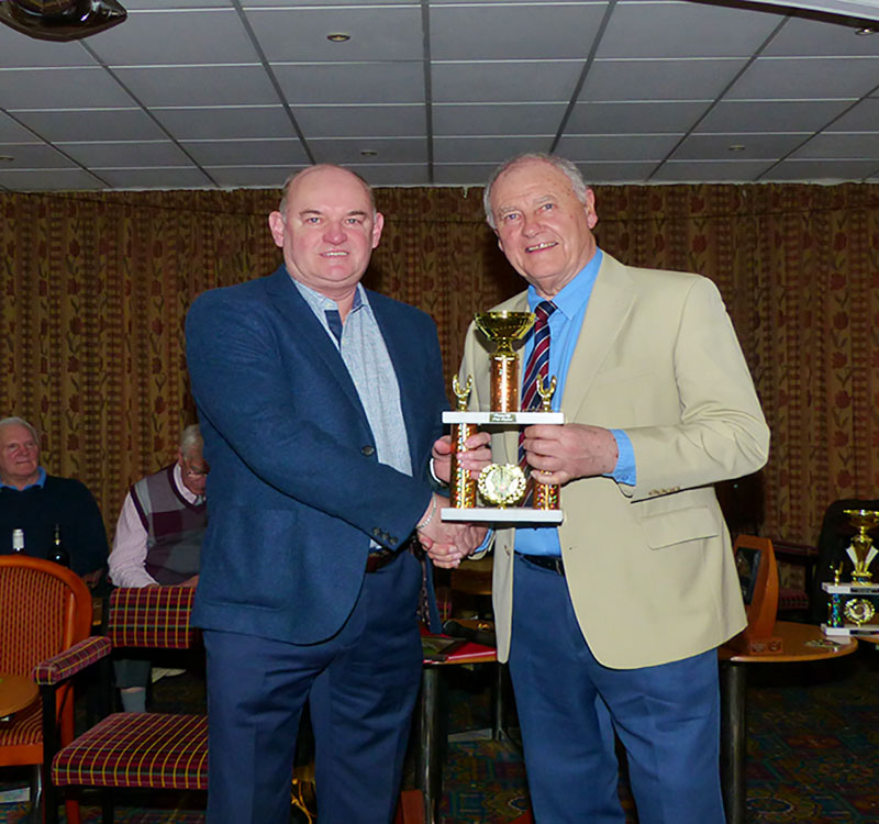 Nigel Holmes collects the Division 1 Merit Trophy from Chairman John Hilton
